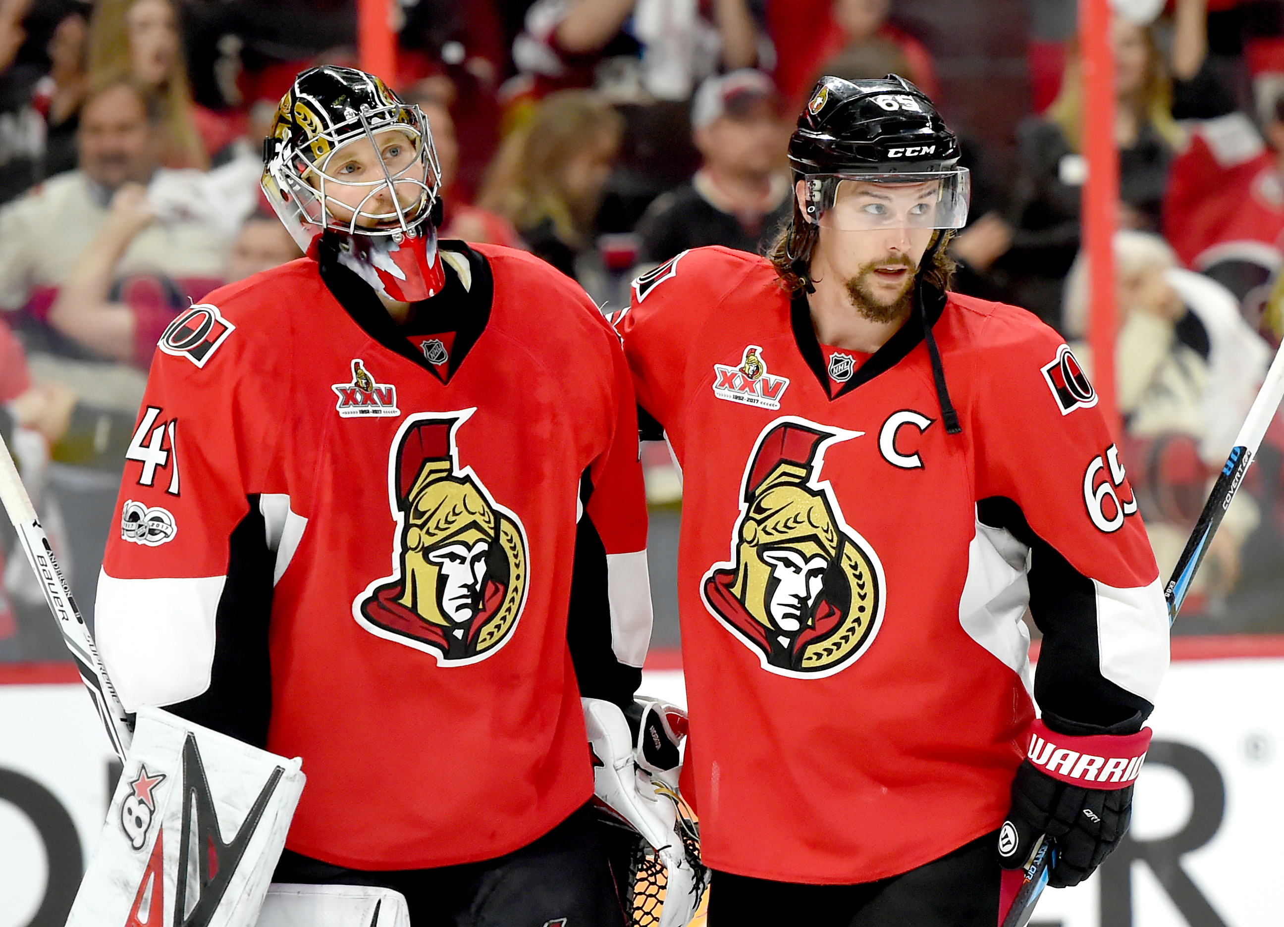 71a66f7183f Ottawa Senators defenceman Erik Karlsson (65) congratulates goalie Craig  Anderson as they celebrate a 2-1 win (Dan Hamilton-USA TODAY Sports)