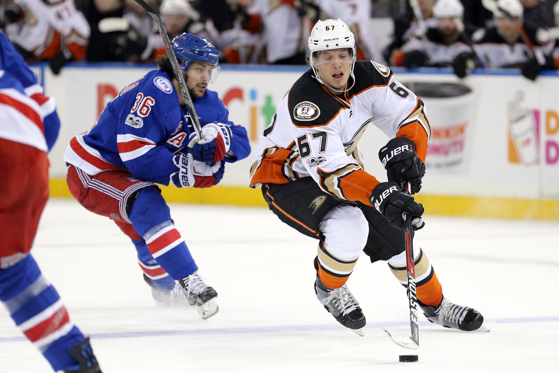 ee9244607 NHL Power Rankings: Anaheim Ducks center Rickard Rakell (67) controls the  puck against